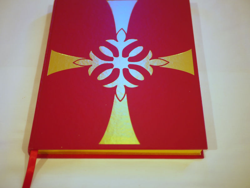 image of red bible with silver cross