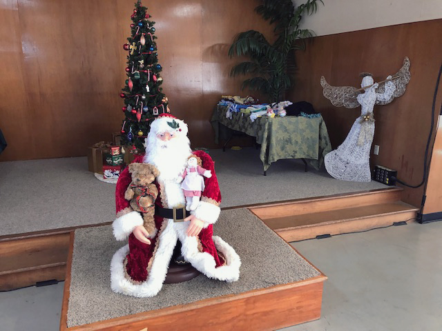 santa statue and Christmas tree