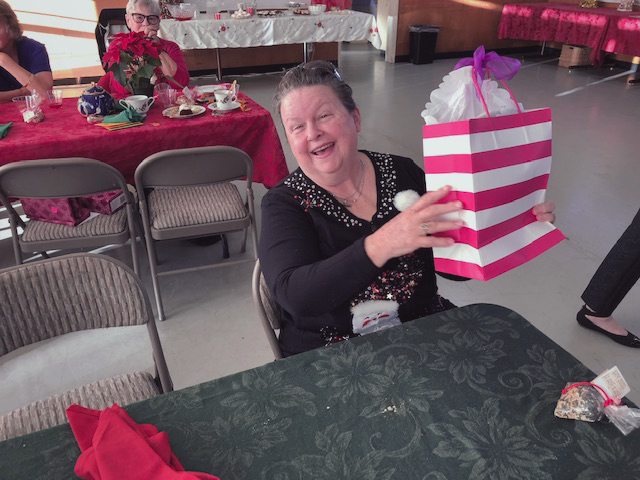 person with gift bag