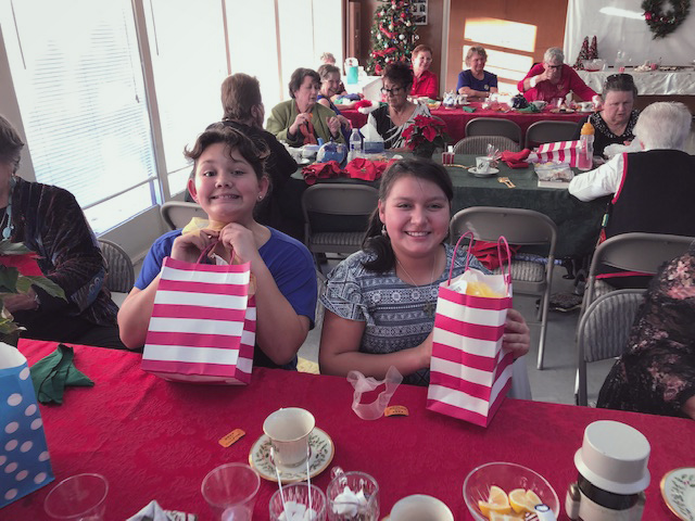 children at table with gift bags