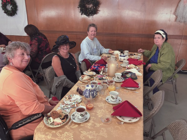 people with table set for tea