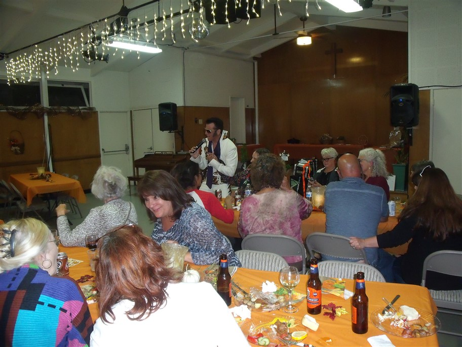 People at table and Elvis impersonator