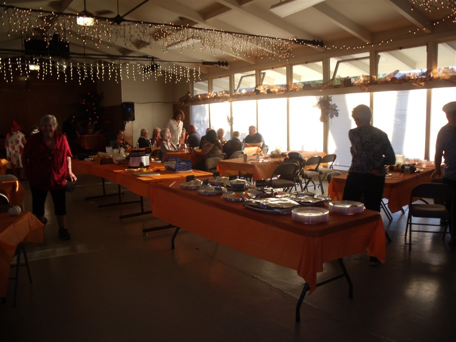 tables of food with orange table cloths